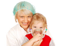 Female doctor gives the child inhalation Stock Images