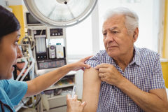 Female doctor giving an injection to a patient Stock Image