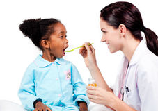 Female doctor giving medicine to her patient royalty free stock images