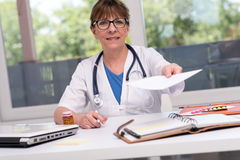 Female doctor giving a prescription Royalty Free Stock Photography
