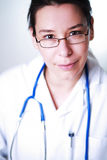 Female doctor with glasses focus on the eyes Stock Photos