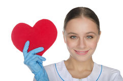 Female doctor in gloves shows a heart symbol Royalty Free Stock Image