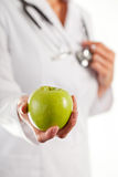 Female doctor with apple. Female doctor with green apple Royalty Free Stock Photo