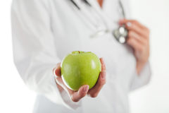 Female doctor with apple Royalty Free Stock Image
