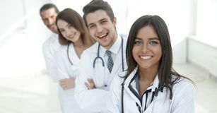 Female doctor with group of happy successful colleagues Stock Image