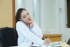 Female doctor had a very exhausting day at work Royalty Free Stock Photo