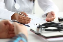 Female doctor hand hold silver pen filling Royalty Free Stock Photography