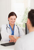 Female doctor hand shaking with a patient Stock Photography