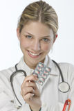 Female doctor handing medicine Royalty Free Stock Photo