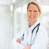 Female doctor with hands folded Royalty Free Stock Photography