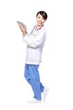 Female doctor happy using tablet pc Royalty Free Stock Photos
