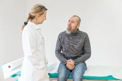 Female doctor is having a consultation stock image