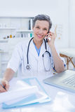 Female doctor having a phone call Stock Image