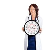 Female doctor healthcare professional holding wall clock Royalty Free Stock Image