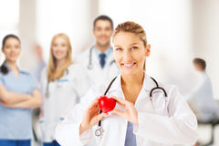 Female doctor with heart. Healthcare and medical concept - female doctor with heart stock photo