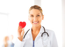 Female doctor with heart. Bright picture of female doctor with heart stock photos
