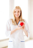 Female doctor with heart Royalty Free Stock Images