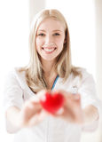 Female doctor with heart Royalty Free Stock Photos