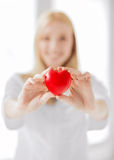Female doctor with heart stock photos