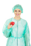Female doctor with heart model. Female surgeon doctor holding heart model royalty free stock images