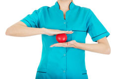Female doctor with heart. Smiling female doctor with heart royalty free stock images