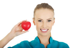Female doctor with heart. Smiling female doctor with heart royalty free stock photos