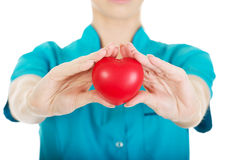 Female doctor with heart. Smiling female doctor with heart stock photos