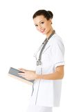 Female doctor with her notebook Royalty Free Stock Photos