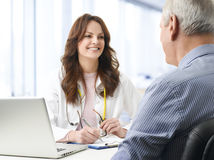 Female doctor with her patient Royalty Free Stock Photo