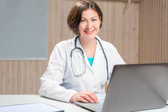 Female Doctor at his desk in the office Stock Photography