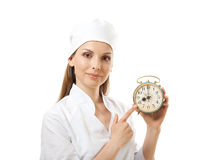 Female doctor holding alarm clock, isolated Stock Images