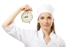 Female doctor holding alarm clock, isolated Stock Image