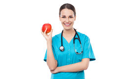 Female doctor holding an apple Royalty Free Stock Images