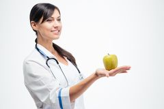 Female doctor holding apple Stock Image