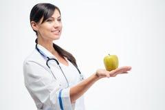 Female doctor holding apple Stock Image