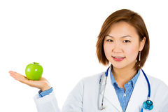 female doctor holding an apple. Stock Images