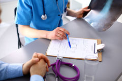 Female doctor holding application form while Stock Images