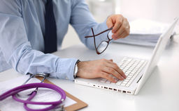 Female doctor holding application form while Royalty Free Stock Photo