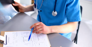 Female doctor holding application form  Stock Photography