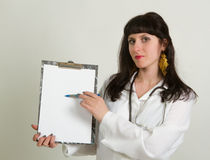 Female doctor holding blank billboard Stock Photography