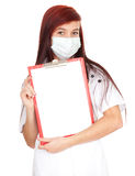 Female doctor holding blank clipboard Royalty Free Stock Images
