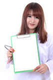 Female doctor holding blank clipboard. Royalty Free Stock Image