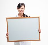 Female doctor holding blank white board Royalty Free Stock Image