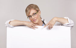 Female doctor holding board Stock Photography