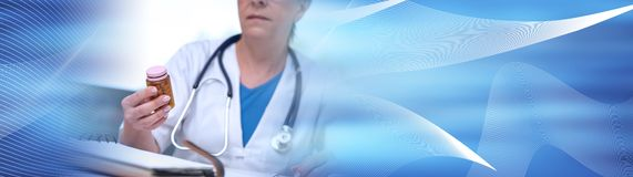 Female doctor holding a bottle of pills. panoramic banner. Female doctor holding a bottle of pills in medical office. panoramic banner stock image