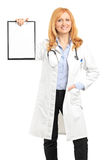 Female doctor holding a clipboard Royalty Free Stock Photo