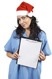 Female doctor holding the clipboard Stock Images