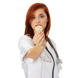Female Doctor holding condom Royalty Free Stock Images