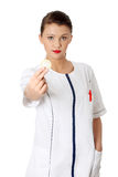 Female doctor holding condom. For aids prevention and birth control, isoalted on white background Stock Photo