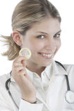 Female Doctor holding condoms Stock Photography